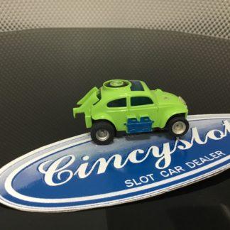 AFX GREEN BAJA BUG HO SLOT CAR, USED NO ENGINE DETAIL.