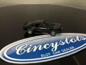 TYCO BLACK TRANS AM BRIGHT GOLD TRIM GREY WHEELS HO SLOT CAR.