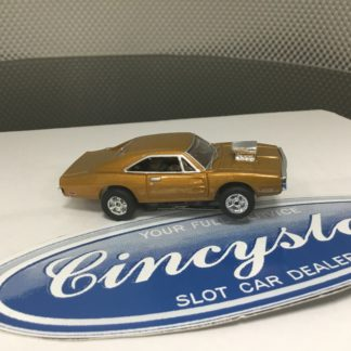 AUTOWORLD FAST & FURIOUS DODGE CHARGER GOLD HO SLOT CAR. NEW.